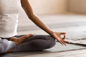 Girl meditating on yoga mat