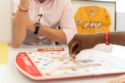A young couple playing scrabble together