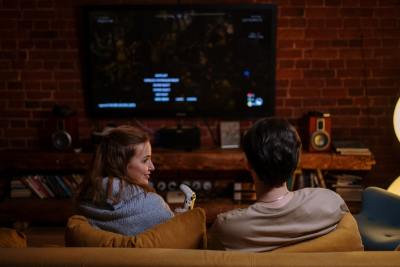 A couple watching netflix on the couch in their house
