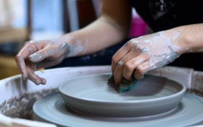 Hands doing pottery