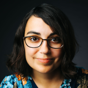 Photograph of Person with Dark Hair and Glasses.