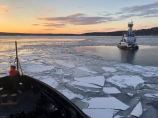 U.S. Coast Guard Cutter Penobscot Bay helps break free tug Stephanie Dann from the ice on the Hudson River near Kingston