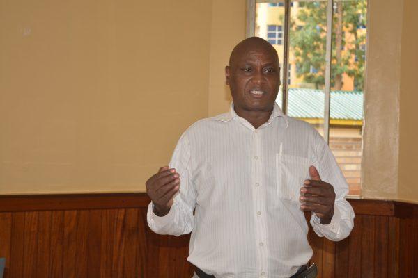 Samuel Kiogora, Program Officer, Community Health Development Unit, giving the opening remarks