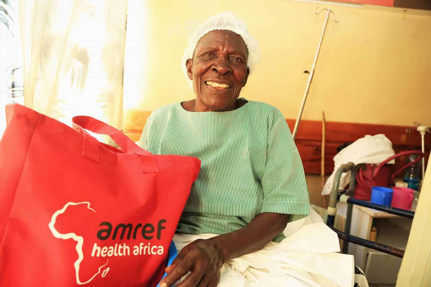 Paskalia happy after receiving dignity pack from Amref