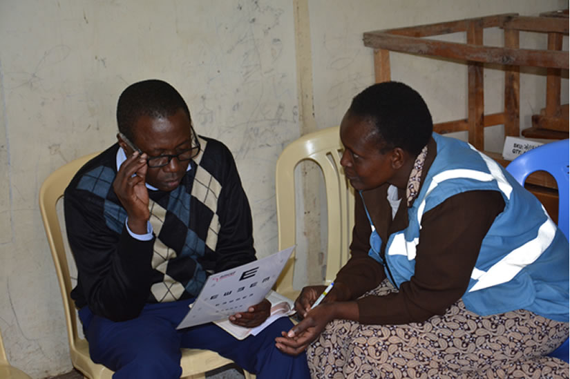 A community health volunteer screens a community member at Deliverance Ong'ata Rongai