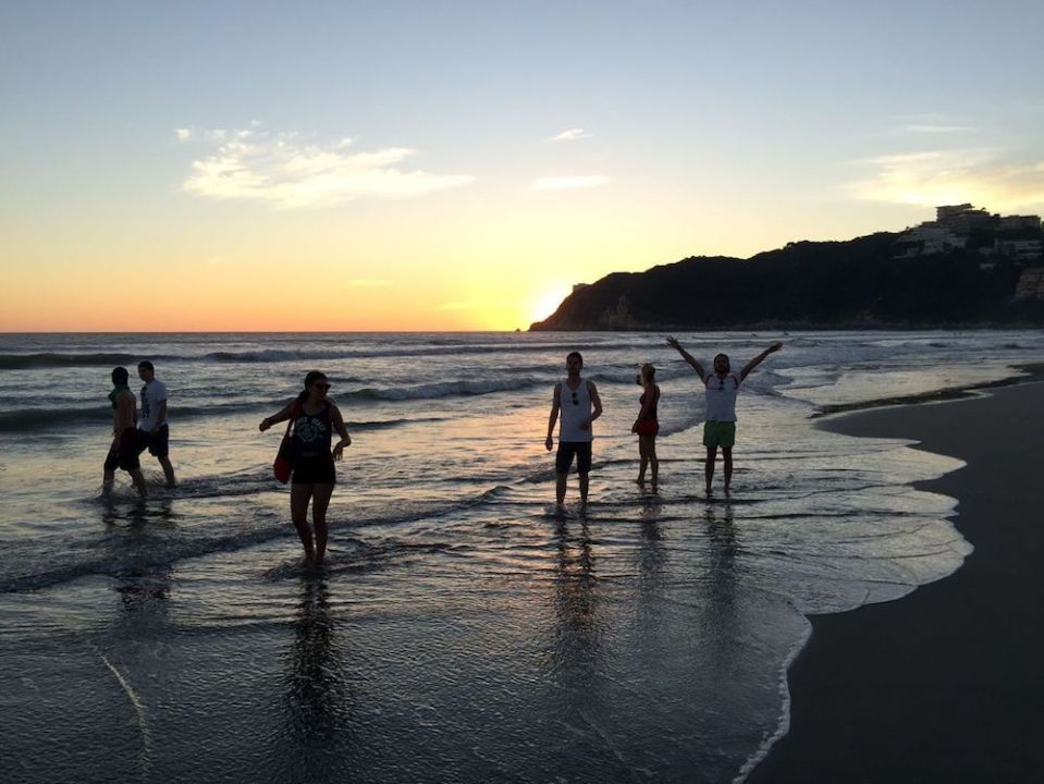 People at the beach, celebrating togetherness in mexico.