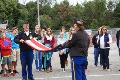The veterans explain how to fold the flag so it may be presented to the next of kin at a funeral.