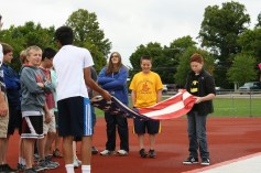 Avonworth students learning how to fold the flag.