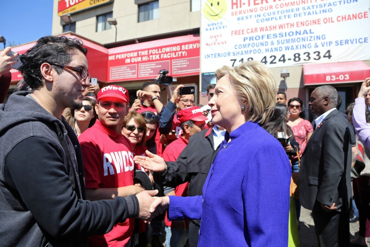 Hillary Clinton visits with Hi-Tek Car Wash workers in April. (200144)