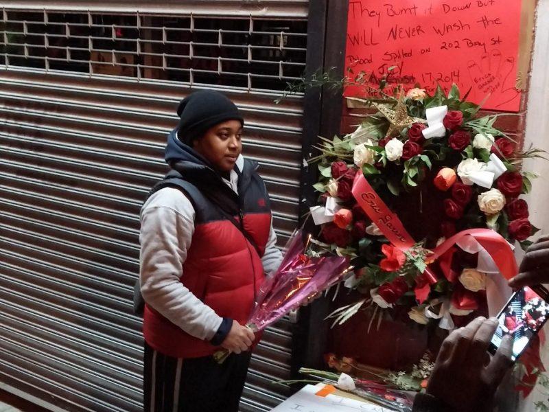 Erica Garner at father's streetside memorial. (220029)