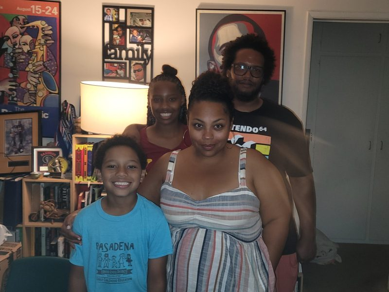 """Los Angeles parent Malissa Barnwell-Scott, here with her husband, Marcus Scott, and their two children, said she is concerned about the """"political craziness"""" surrounding this school year. """"I feel like people have turned it into something it's not,"""" she said. """"It's public health and should be treated that way."""" (309078)"""