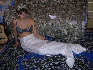Russian woman dressed up as a mermaid for a dating site photo
