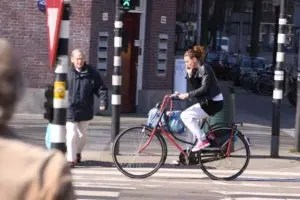 cycling while using a smartphone in Amsterdam