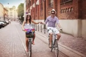 couple cycling hand in hand on Valentine's Day in Amsterdam