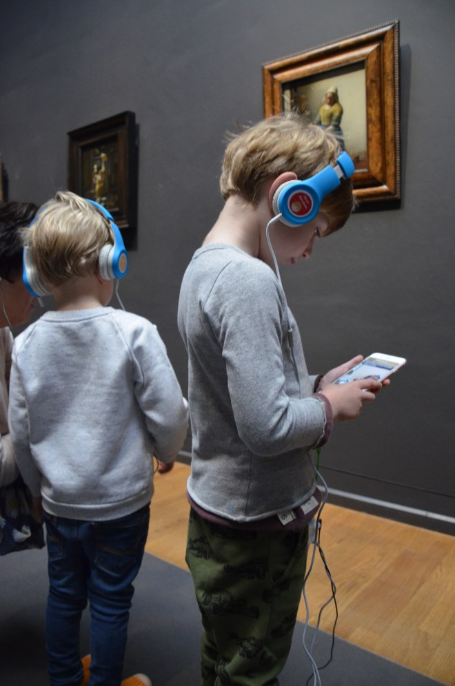 Amsterdam with kids - children enjoying the Rijksmuseum app
