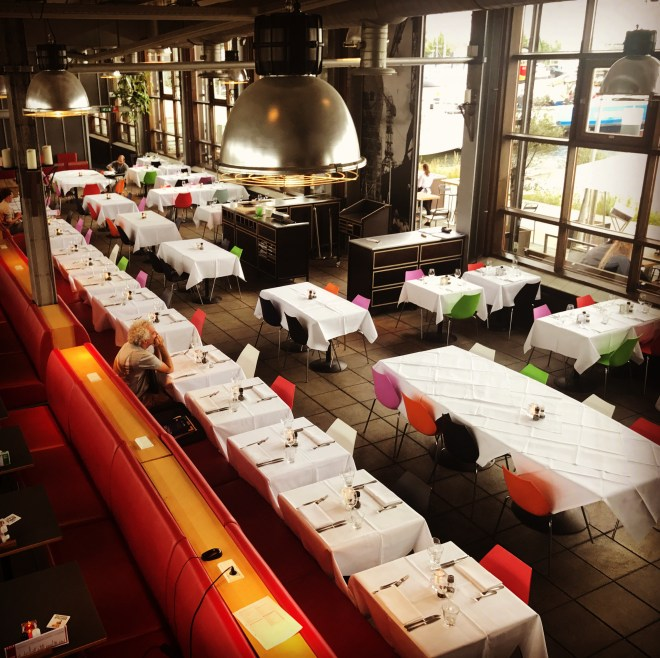 Amsterdam with kids - colourful tables at the Ij Kantine