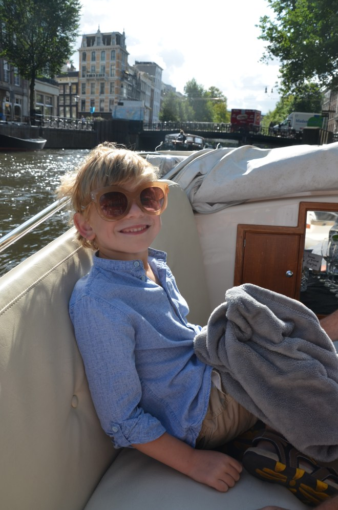 Boy enjoying a canal trip with Pure Boats in Amsterdam