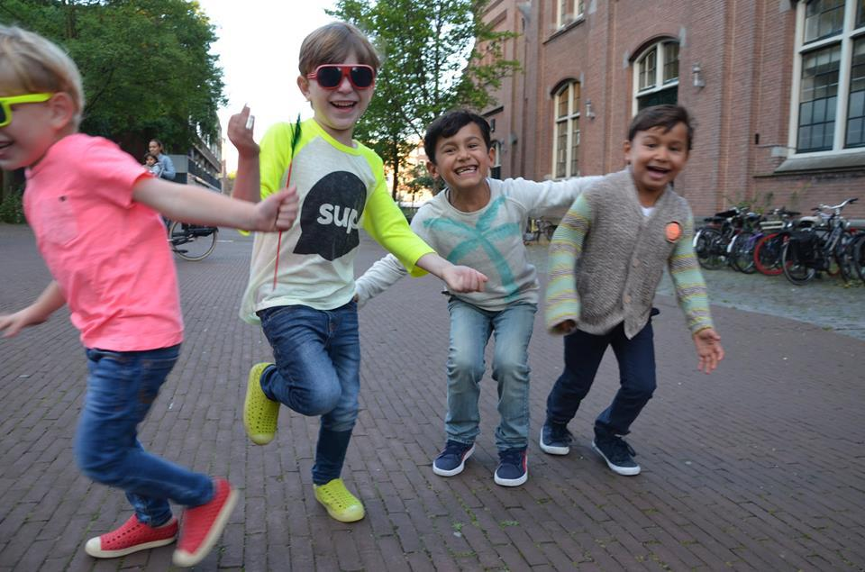 Things to do with kids in Amsterdam - kids having fun running towards the camera