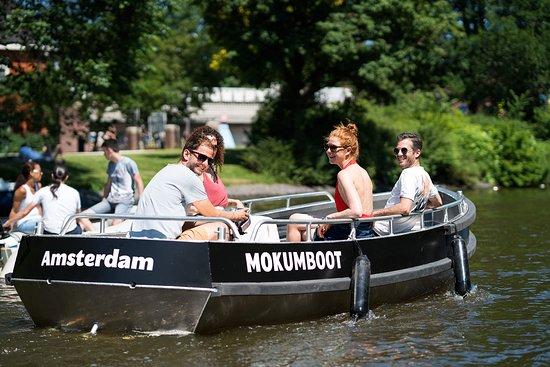 Teenagers enjoying Mokum boat Amsterdam