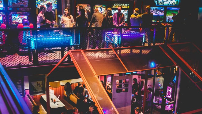 People playing on the games machines at the TonTon Club Amsterdam