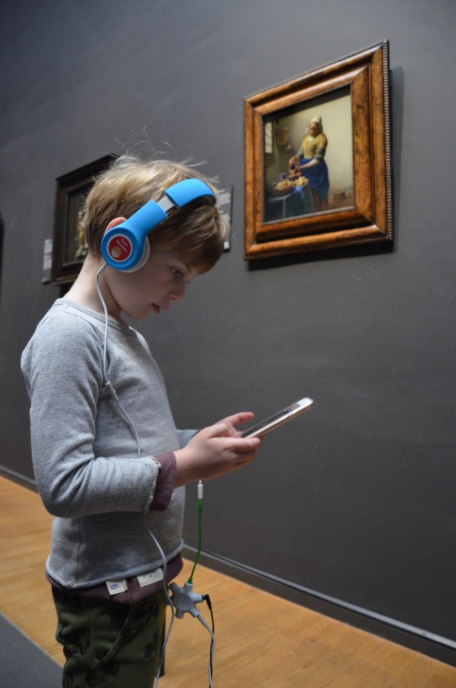 Boy enjoying the Rijksmuseum app
