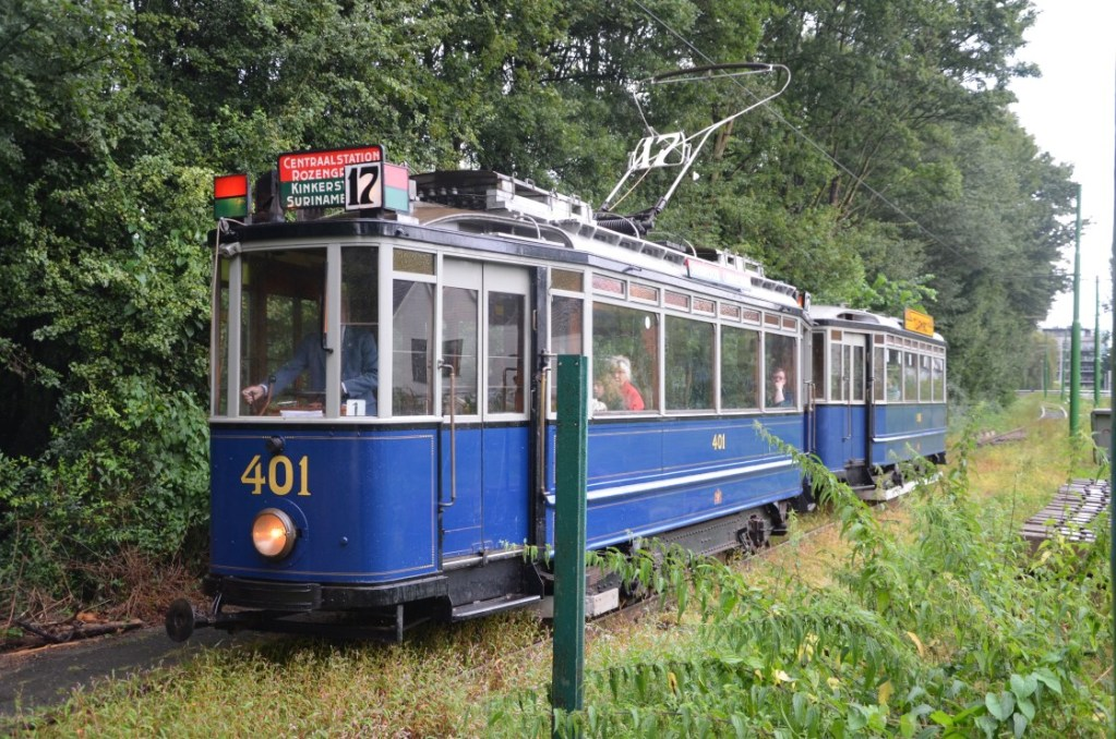 The historic tram driving through the woods in Amsterdam