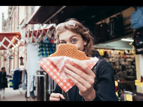 Teenager with stroopwafel Amsterdam