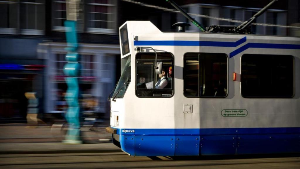 A tram whizzing through the Amsterdam streets
