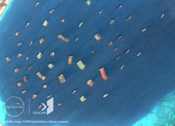 Chinese fishing vessels at Subi Reef on August 12, 2018. © DigitalGlobe, Inc. and © Vulcan Technologies LLC. All Rights Reserved