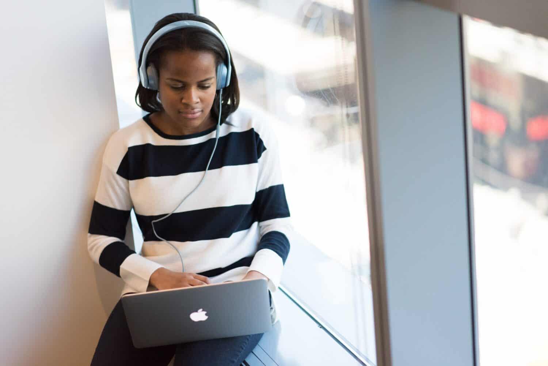 woman-transcribing-audio- files-on-laptop