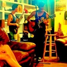 Chris Puckett playing at coffee shop