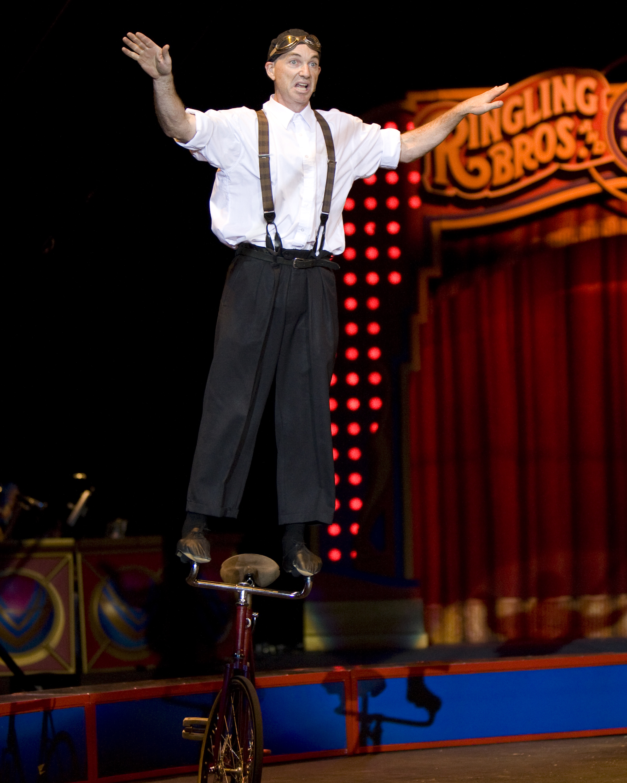 Justin Case riding handlebars. Photo courtesy of Ringling Bros.