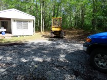 The bulldozer in our yard and extra gravel.