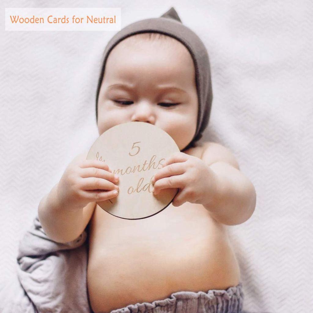 Baby Holding Milestone Card