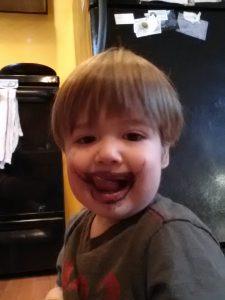 Tiny mustachioed Joker really enjoys his kale smoothies...