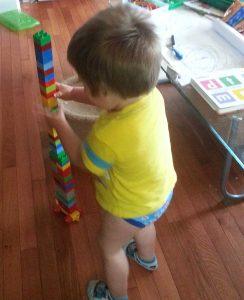 Alvie in his Thomas Underoos building a vewy, vewy, vewy high tower.