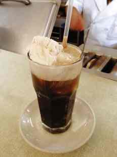 Coca-Cola Float, sitting at the counter, chatting to the staff.