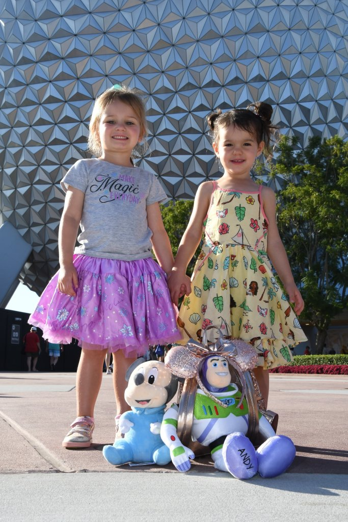 Little girls and stuffed animals in front of Spaceship Earth at Epcot