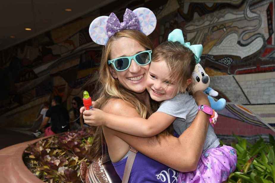 Chloe hugging her momma at Disney World!