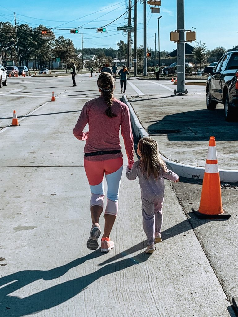 Running with my best little running buddy around mile 10 of the Cypress Half Marathon!