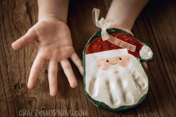 Salt dough handprint ornaments! Santa handprint ornament. DIY Christmas ornaments for toddlers.