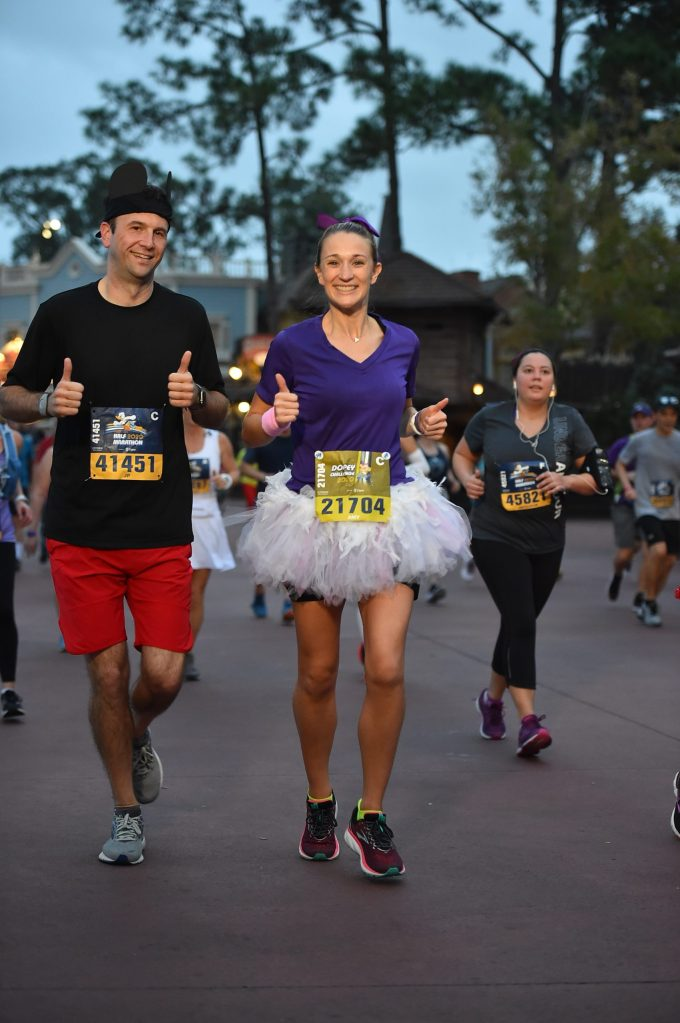 Running through Frontierland at Magic Kingdom during the Disney World half marathon.