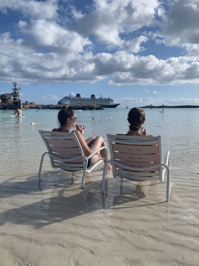 Enjoying the sun and sand at Disney's Castaway Cay with the Disney Dream in the background.