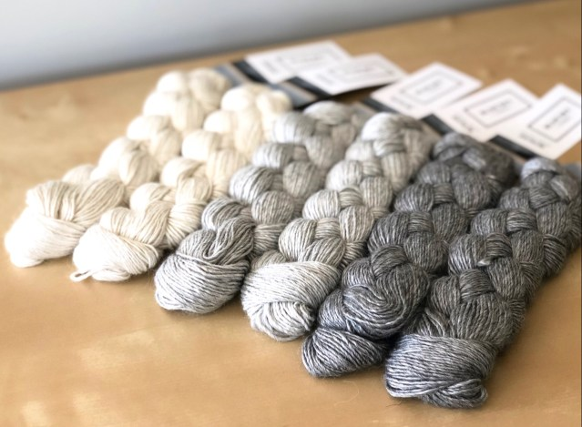 Three colors of shiny gray yarn, with the sheen of silk fuzzed by the halo of alpaca.