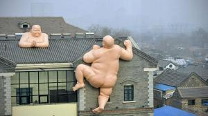 Naked Buddha sculptures unveiled in Jinan, Shandong province, China - 19 Jan 2014