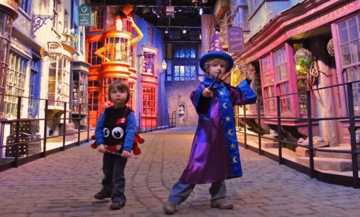 A wee wizard & his brother, a mini-Aragog, strike a pose in Diagon Alley.