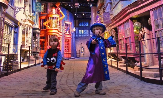 A wee wizard & his brother, a mini-Aragog, strike a pose in Diagon Alley at the Warner Bros. Harry Potter studio tour in Leavesden, near London
