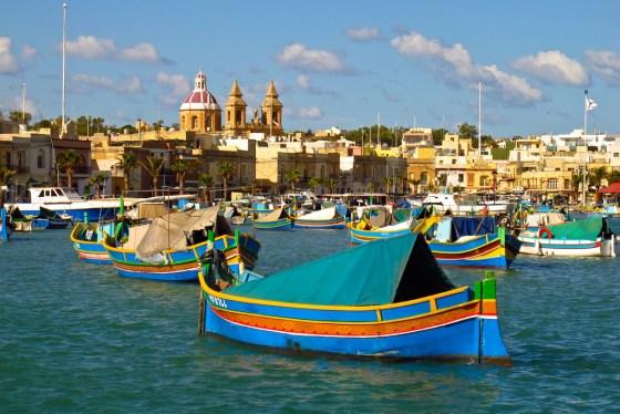 Traditional Maltese boats bob in the harbor of Marsaxlokk.