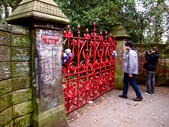 John Lennon used to climb a tree in his aunt's backyard to peer over the fence at Strawberry Fields, a former boys' home.