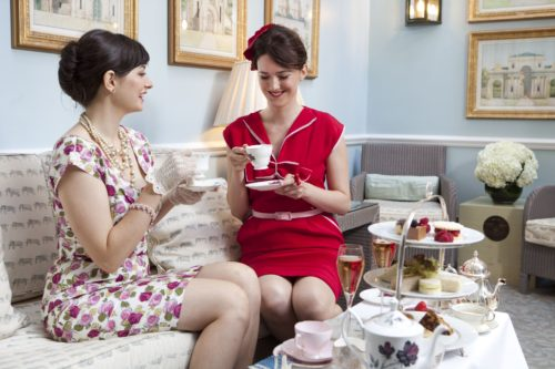 """Is that gin in their cups? Hmmm...could be, if they're drinking Dukes' new """"G & Tea."""" Courtesy Dukes St. James."""